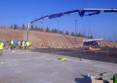 Crew on slab placement with pump truck