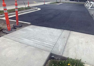 New access ramp with curb and gutter