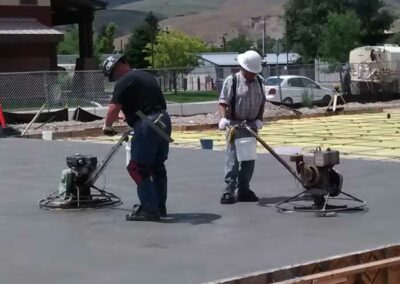 Rulon and his son Bear power troweling SMMC clinic  slab on-grade